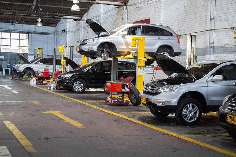 What is the cost of servicing a car in Singapore?